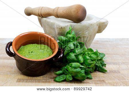 pesto sauce with fresh basil, mortar and pestle