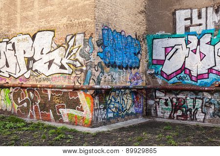 Abandoned Courtyard With Colorful Graffiti Text