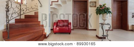 Corridor With Elegant Stairs And Armchair