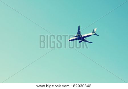 Airplane Flying In The Blue Sky On High Distance