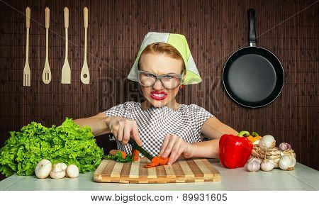 Happy Funny Woman Cook Working In The Kitchen Cutting Carrot