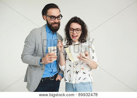 Hipster Team With Smartphone Tablet Celebrating Success Isolated On White
