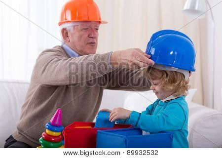 Grandfather And Grandkid Wearing Helmets