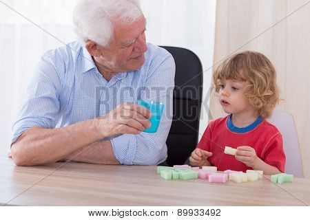 Caring Grandfather And Cute Grandchild