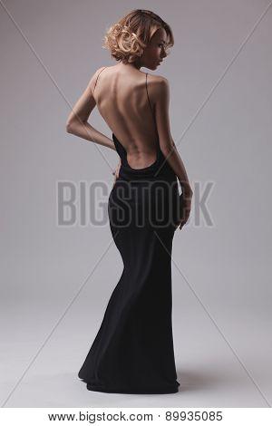 beautiful woman model posing in elegant dress