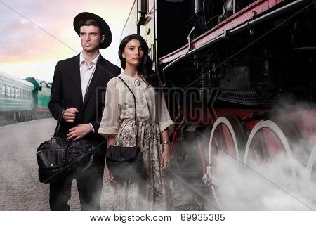 Stylish Young Couple On Vintage Railroad Station