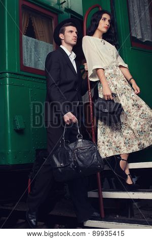 Fashionable Couple Posing On Vintage Train Car
