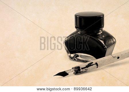 Antique pen and black ink pot