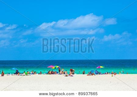People Enyoy The South Beach In Miami