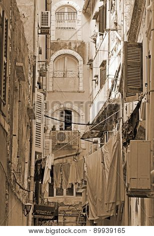 Greece. Corfu Island. A Typical Courtyard In The Center Of Corfu Town.  In Sepia Toned. Retro Style
