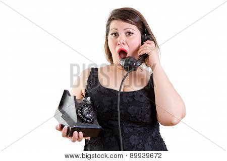 Astonished Woman Talking On A Telephone