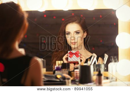 Portrait Of A Beautiful Woman With Gift Box