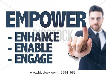 Business man pointing the text: Empower