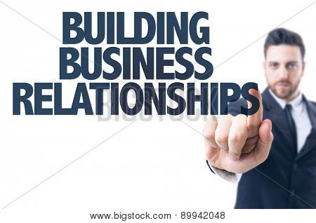 Business man pointing the text: Building Business Relationships