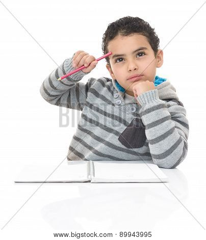 Serious Studying Boy Thinking For Answer