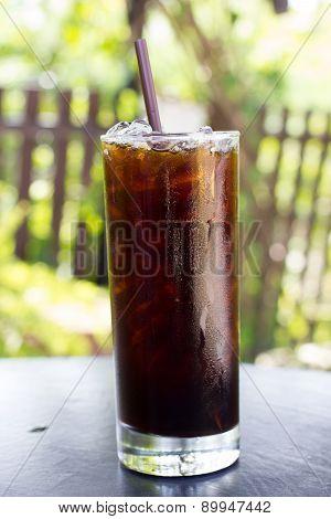 Iced Americano On Wood Table.