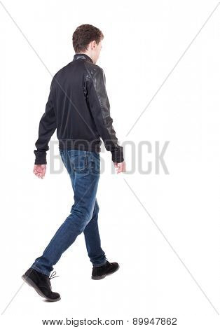 Back view of going  handsome man in jacket.  walking young guy . Rear view people collection.  backside view of person.  Isolated over white background. The guy in the demi-season jacket leaves