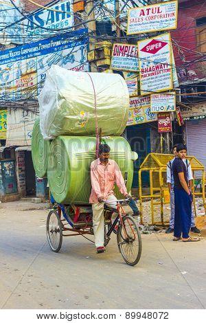 Rickshaw Rider Transports Heavy Load