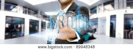 Businessman In His Office Using Tactile Interface