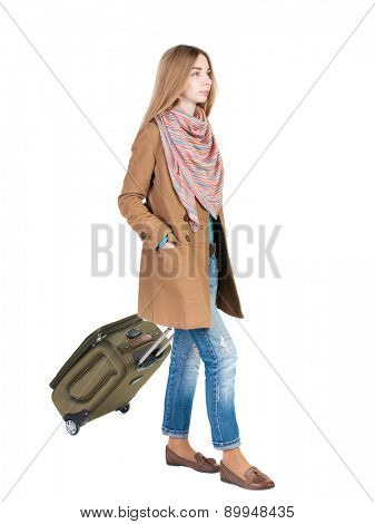 back view walking woman with suitcase. beautiful girl in motion.  backside view of person.  Rear view people collection. Isolated over white background. traveling teen girl. sad girl rolls a suitcase.