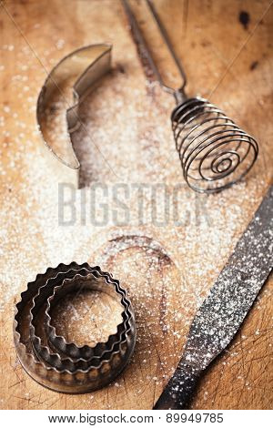 abstract picture with Vintage  Baking utensils and flour on wooden backdrop