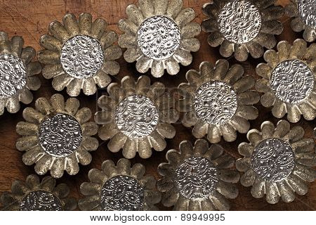 abstract picture with Vintage Baking Tins or molds on wooden table background