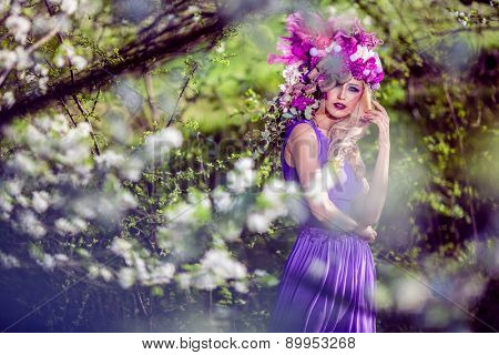 Fairies are real, beautiful Woman wearing a flower crown symbolizing spring - all images in this series shot with an open aperture - very shallow depth of field