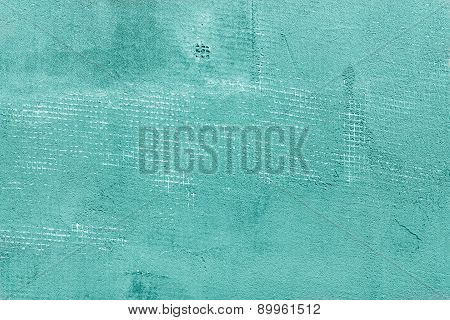 Splitted And Cracked Turquoise Concrete Wall With Net And Holes, Textured Cement Background
