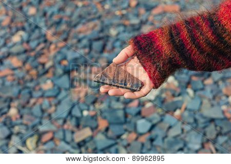Woman Holding A Piece Of Slate