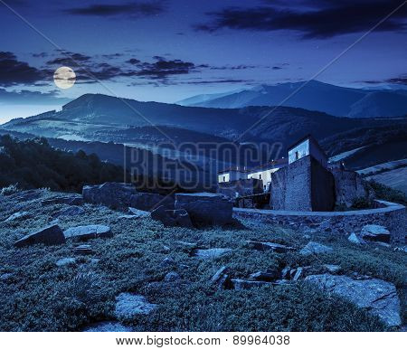 Composite Landscape With Fortress In Woods On Mountain Hillside At Night