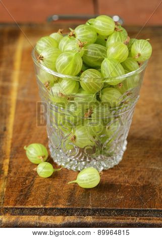 berries green gooseberries in a glass on the table