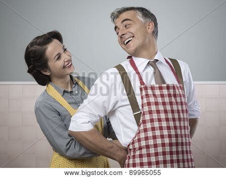Vintage Loving Couple In The Kitchen