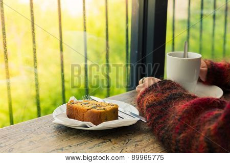 Woman Drinking Tea And Having Cake