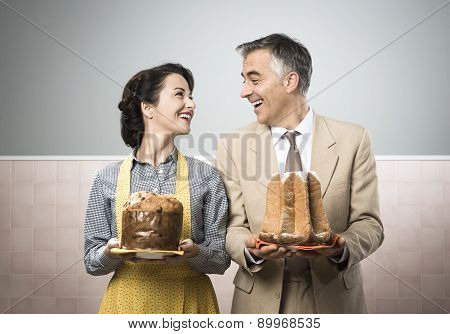 Smiling Couple At Home With Christmas Cakes