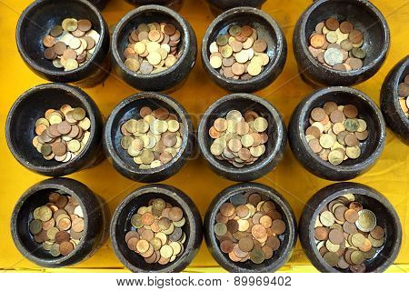 Thai Coin In Buddhist Monk's Alms Bowl