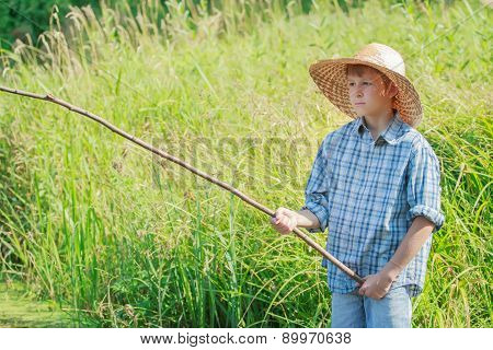 Angler Concentrated Boy Watching After Handmade Fishing Rod Float On Water