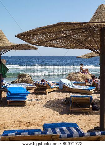 Tourists Tan On The Beach