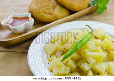 Potato curry with black cumin seeds