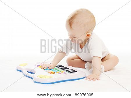 Curious Baby Playing With Toy Piano On A White Background