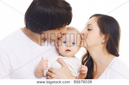 Happy Family, Portrait Of Mother And Father Kissing Baby