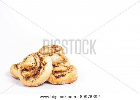 isolated sweet buns with cinnamon