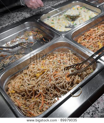 Spaghetti And Rice With Vegetables In The Chinese Restaurant