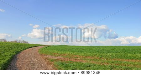 Winding Way On The Hill And Blue Sky With Clouds