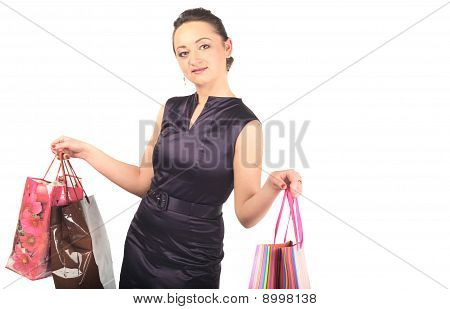 Young happy woman with shopping bags.