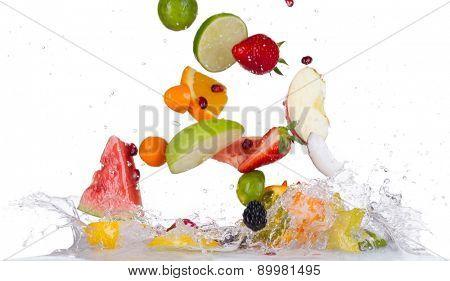 Mix of fresh fruit with water splashes isolated on white background