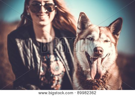 The Husky Dog And Happy Girl Behind