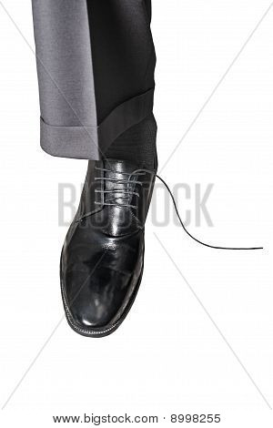 Leg In Leather Shoe On White