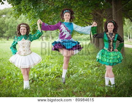 Three Young Beautiful Girls In Irish Dance Dress Posing Outdoor