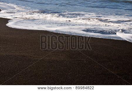 Waves Spread On Black Sand Beach