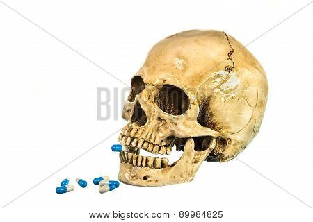 Side View Of Human Skull With Pill In Teeth